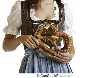 Bavarian girl in Dirndl cloth holding Oktoberfest Pretzel