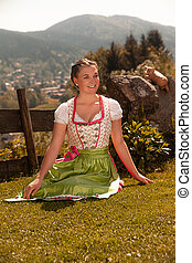 Bavarian girl in the grass
