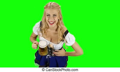 Bavarian girl with a glass of beer in his hand flirts. Green screen