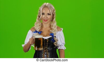 Bavarian girl with beer showing thumbs up. Green screen