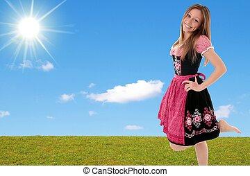 Bavarian girl with leg up