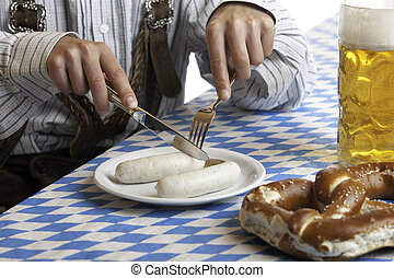 Bavarian Man having Oktoberfest meal - Bavarian man dressed...
