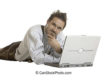 Bavarian man looks contemplative in front of his laptop