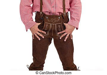 Bavarian man with oktoberfest leather trousers stands casual...