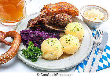 Bavarian meal - Appetizing Bavarian roast pork dish with...