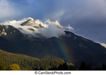 Bavarian mountain Wendelstein with fog and rainbow