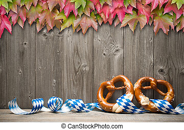 Background for Oktoberfest - Bavarian pretzels with ribbon ...