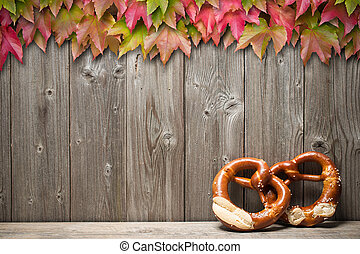 Background for Oktoberfest - Bavarian pretzels with ribbon...
