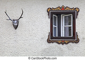 bavarian rural window with typical painted frame decorations