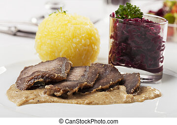 bavarian sauerbraten, a marinated beef speciality