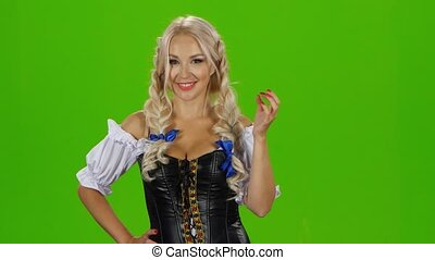 Bavarian sexy woman playing with her hair curl. Green screen