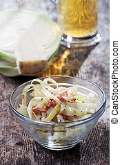 bavarian white cabbage salad in a glass bowl