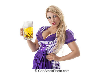 bavarian woman in a dirndl with beer