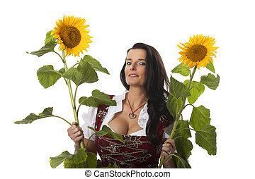 bavarian woman in a dirndl with sunflowers