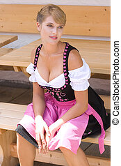 Bavarian woman in a dirndl - Woman in traditional Bavarian...