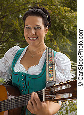 Bavarian woman in dirndl smiling wh