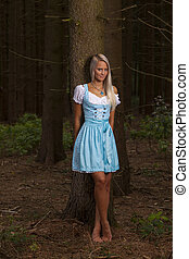 bavarian woman in the forrest