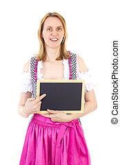 Bavarian woman pointing to clean blackboard