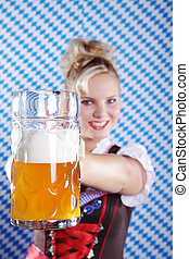 Bavarian woman raises beer mug