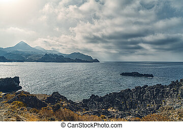Bay and mountain ranges with dramatic skies in Crete