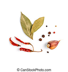 bay leaf, garlic and chilli pepper on a white background
