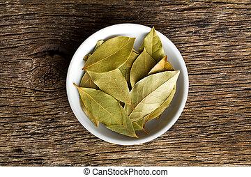 bay leaves in ceramic bowl - the bay leaves in white ceramic...
