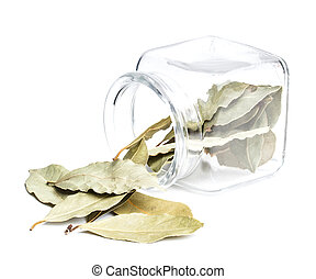 Bay leaves in the overturned glass jar