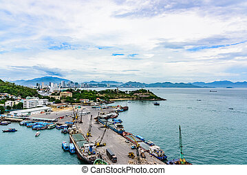 bay mooring in port of vietnamese city in south china sea - ...