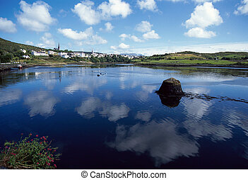 Bay of Clifden : sea, village, and reflections of dappled sky in Connemara, Ireland