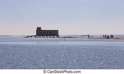 Bay on the beach of Fuseta, a marine rescue house Tavira...