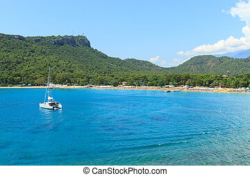 Bay with turquoise color of the sea and yachts in Kemer
