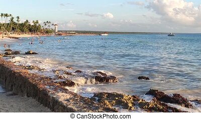 Bayahibe seascape at sunset with a lighthouse in the ...