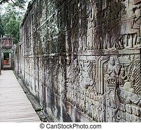 Bayon Temple stone wall carving. Angkor, Siem Reap,...