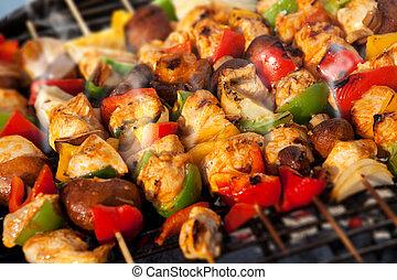 BBQ barbecuing skewers kebab - Bar-B-Q or BBQ with kebab...