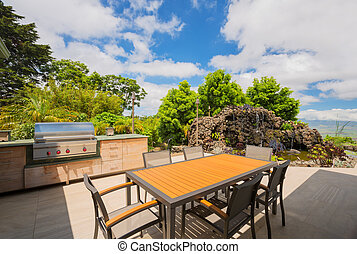 BBQ grill on deck - Backyard patio with BBQ grill and dining...