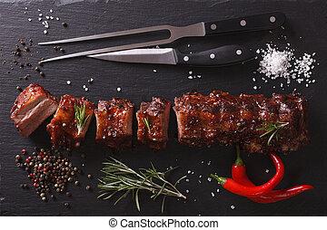 BBQ pork ribs on a table. horizontal top view - BBQ pork...