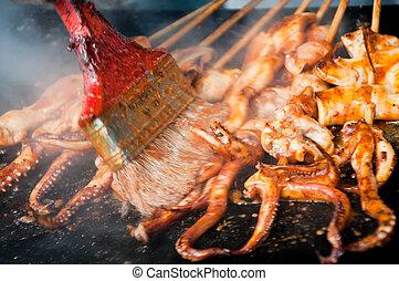 bbq squid 2 - bbq squid being prepared on a skillet