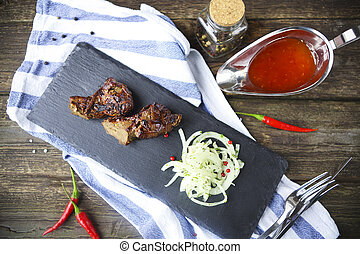 BBQ steak. Barbecue grilled beef steak meat. Healthy food. Barbeque steak dinner