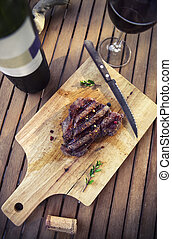 BBQ steak. Barbecue grilled beef steak meat with red wine and knife