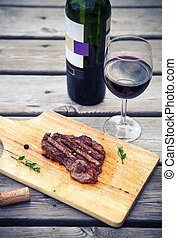 BBQ steak. Barbecue grilled beef steak meat with red wine
