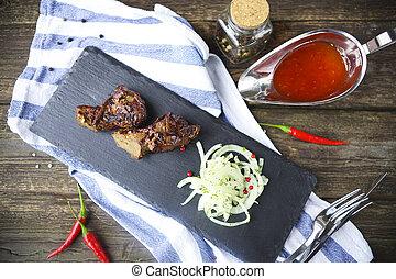BBQ steak. Barbecue grilled beef steak meat. Healthy food. Barbeque steak dinner