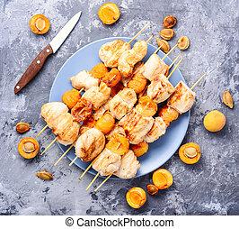 Bbq turkey meat on wooden skewers