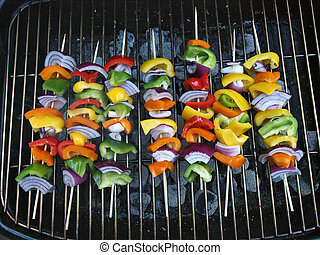 BBQ Vegetable Kabob - Assorted vegetables cooking on a...