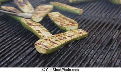 Bbq zucchini on a grill. Barbecue vegetables cooking at the...