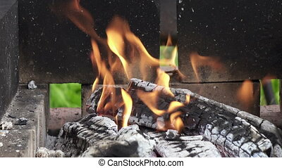 BBQ,wooden logs burning in a brazier in the street,Wooden ...