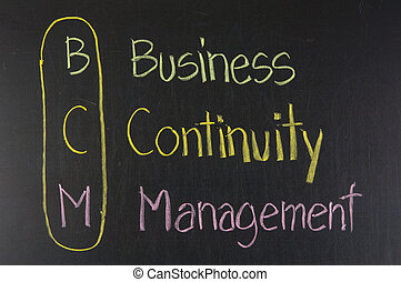 BCM acronym Business Continuity Management, color chalk handwriting on blackboard