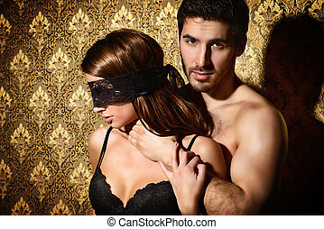 bdsm games - Sensual young woman with lace ribbon on her...
