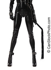 Legs of slim sexy woman in black latex catsuit with cuffs and whip on white background