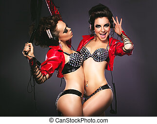 Bdsm. Playful Women in Sexy Costumes with Lash