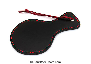 BDSM Toy - Black and Red BDSM paddle isolated on a white...